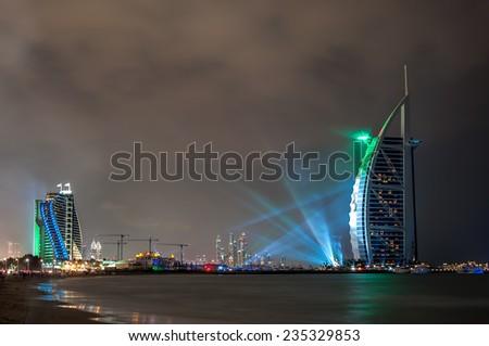 DUBAI, UAE - Dec 1: UAE 43rd National Day 2014 celebration and Fireworks show at Burj al Arab on December 1,2014 in Dubai, UAE. - stock photo