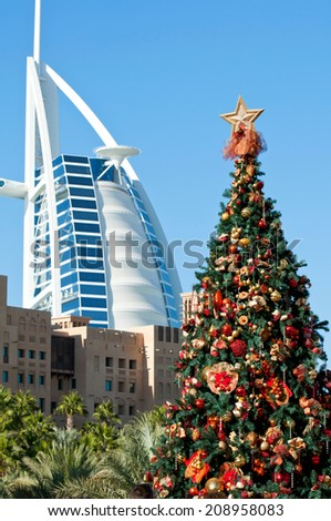 DUBAI, UAE - DECEMBER 25, 2013: Burj Al Arab in Dubai, as seen on December 25, 2013. It is a 7-star hotel built on an artificial island and is the fourth tallest hotel in the world. - stock photo