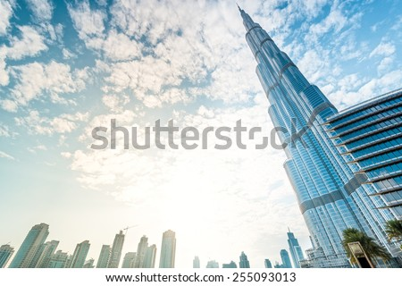 Dubai, UAE - December 8, 2012: Burj Khalifa vanishing in blue sky. It is tallest structure in world since 2010, 829.8 metres. - stock photo