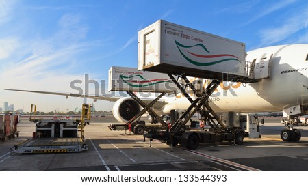 DUBAI, UAE - DECEMBER 26: Emirates Boeing 777 at Dubai Airport on December 26, 2012 in Dubai, UAE. Emirates is rated as a top 10 best airline in the world flying on youngest fleet. - stock photo