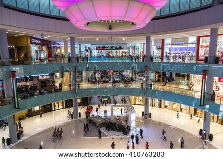 DUBAI, UAE - DECEMBER 5: Shoppers in Dubai Mall, UAE. December 5, 2015 in Dubai, United Arab Emirates - stock photo