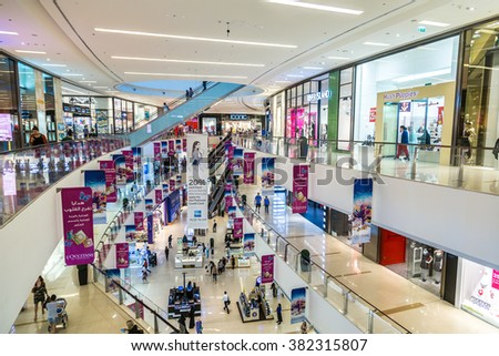 DUBAI, UAE - DECEMBER 5: Shoppers in Dubai Marina Mall, UAE. December 5, 2015 in Dubai, United Arab Emirates - stock photo