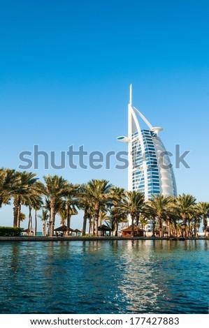 DUBAI, UAE - DECEMBER, 10, 2013: View of hotel Burj al Arab from Madinat Jumeirah in Dubai. - stock photo