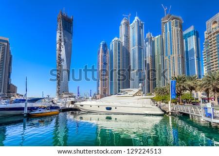 DUBAI, UAE - FEB 20: Dubai Marina the largest marina in the world,artificial canal city, carved along a two mile  stretch of Persian Gulf shoreline ,February 20, 2013 in Dubai, United Arab Emirates - stock photo