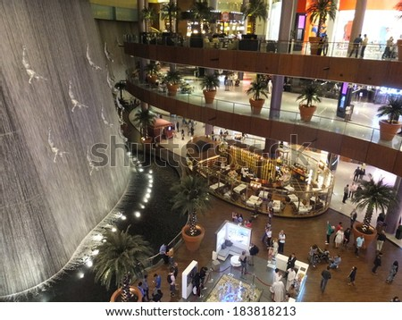 DUBAI, UAE - FEB 16: Waterfall at Dubai Mall in Dubai, UAE, as seen on Feb 16, 2014,. The mall is the world's largest shopping mall based on total area and 6th largest by gross leasable area. - stock photo