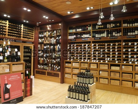DUBAI, UAE - FEB 22: Wine store at Dubai Duty Free at the International Airport, as seen on Feb 22, 2014, in Dubai, UAE. It is the worlds largest airport retailer based on turnover. - stock photo