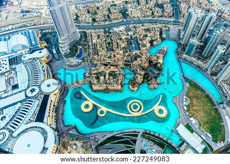DUBAI, UAE - FEBRUARY 08: Aerial view of Downtown Dubai with Dubai Fountain and skyscrapers from the tallest building in the world, Burj Khalifa, at 828m, taken on 08 February 2013 in Dubai, UAE. - stock photo
