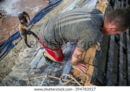 DUBAI, UAE - FEBRUARY 26, 2016: Competitors participate in the 2016 Spartan Race obstacle racing challenge in Dubai, United Arab Emirates, on February 26, 2016. - stock photo