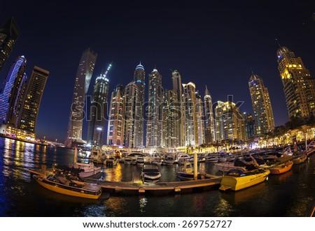 DUBAI, UAE - FEBRUARY 28:  Dubai Marina at dusk. Dubai Marina is an artificial canal city, built along a 3 km stretch of Persian Gulf shoreline. Picture taken on February 28, 2015. - stock photo