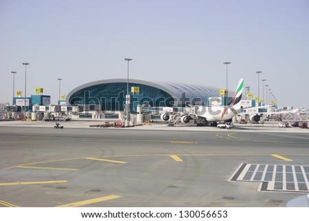 DUBAI, UAE - FEBRUARY 13: Emirates Airbus A340 at Dubai Airport on February 13, 2013 in Dubai, UAE. Emirates handles major part of passenger traffic and aircraft movements at the airport. - stock photo