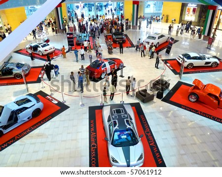DUBAI, UAE - FEBRUARY 19: Luxury sports cars on display during Auto Exhibition at Dubai Mall February 19, 2010 in Dubai, United Arab Emirates. - stock photo