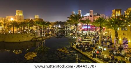 Dubai - UAE, February 27 2014: Panoramic view of Souk Madinat Jumeirah at night on February 2014 in Dubai UAE. - stock photo