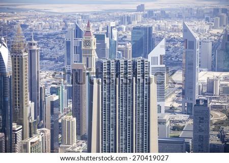 DUBAI, UAE - FEBRUARY 24 - View of downtown Dubai from Burj Khalifa, United Arab Emirates. Picture taken on February 24, 2015.  - stock photo