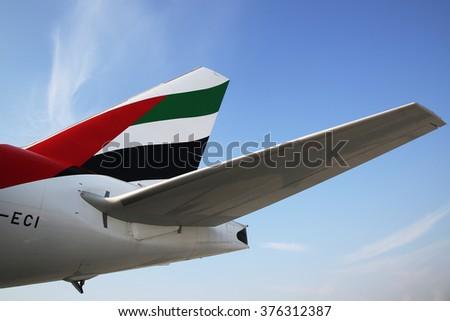 DUBAI, UAE - JANUARY 22, 2016:  Emirates Airline tailfin at Dubai International  Airport - stock photo