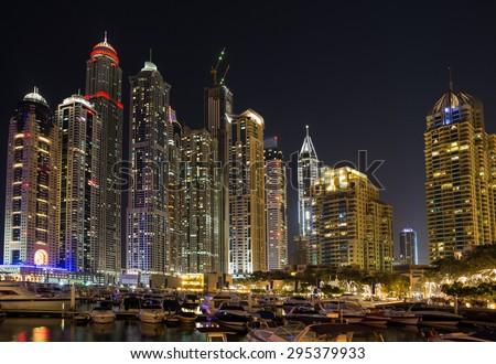DUBAI, UAE-JANUARY 16: Skyscrapers in the Dubai Marina on January 16, 2014 in Dubai, UAE. Modern skyscrapers in the in the Dubai Marina at night. - stock photo