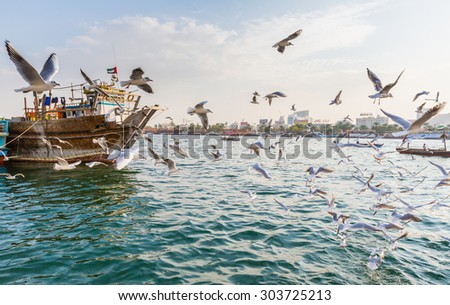 DUBAI, UAE-JANUARY 18: Traditional Abra ferries on January 18, 2014 in Dubai, UAE. Shipbuilding technology is unchanged from the 18th century. - stock photo