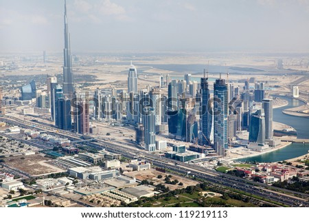 DUBAI, UAE - JANUARY 20: View at Sheikh Zayed Road skyscrapers in Dubai at January 20, 2011. More than 25 skyscrapers taller than 100 meters and the highest building in the wordl Burj Khalifa - stock photo