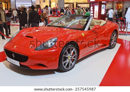 Dubai, UAE - January 06, 2012: View of a Ferrari California supercar in Dubai Mall gallery. The California was launched by Ferrari at the 2008 Paris Motor Show. It is a two door hard top convertible. - stock photo