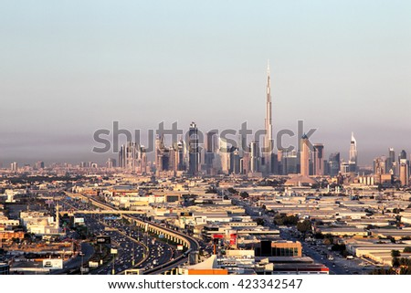 DUBAI, UAE - JANUARY 31, 2015: View of Dubai Skyline showing the Burj Khalifa, the tallest building of the world, seen from the Mall of the Emirates. - stock photo