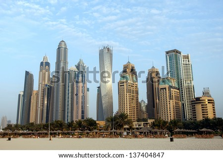 DUBAI, UAE - JANUARY 7: View of modern skyscrapers in Dubai Marina on January 7, 2013 in Dubai, UAE. Dubai Marina - artificial canal city, carved along a 3 km stretch of Persian Gulf shoreline. - stock photo