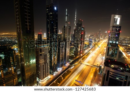 DUBAI, UAE - JANUARY 10: View of Sheikh Zayed Road skyscrapers in Dubai, UAE on JANUARY 10, 2013. More than 25 skyscrapers can be found here. - stock photo
