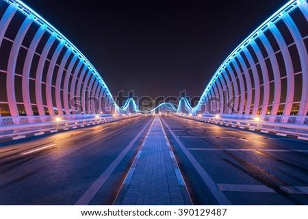 Dubai, UAE July, 19 2015, Meydan Bridge at night with natural architectural mirror - stock photo