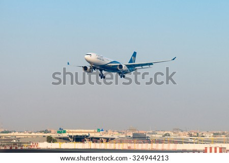 DUBAI, UAE - 17 JULY 2014: Passenger liner from Oman Air, on final approach for landing at Dubai International Airport. - stock photo