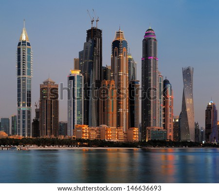 DUBAI, UAE - JUN 25: Dubai Marina skyline as seen from Palm Jumeirah on Jun 25, 2013 in Dubai, UAE. This part of Dubai has more skyscrapers over 50 stories that Manhattan - stock photo