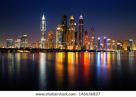 DUBAI, UAE - JUN 25: Dubai Marina skyline as seen from Palm Jumeirah on Jun 25, 2013 in Dubai, UAE. This part of Dubai has more skyscrapers over 50 stories that Manhattan - stock photo