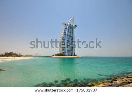 DUBAI, UAE - JUNE 28, 2012: Burj Al Arab in Dubai, as seen on June 28, 2012. It is a 7-star hotel built on an artificial island and is the fourth tallest hotel in the world. - stock photo