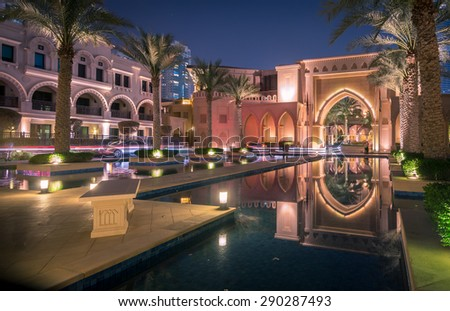 Dubai / UAE - June 5: Entrance of Hotels, offices and Souk Al Bahar near Burj Khalifa the tallest building in the world on June 5 ,2015 in Dubai. - stock photo