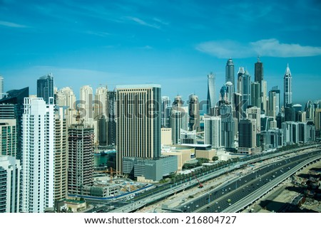 DUBAI, UAE - MAR 23: A skyline panoramic view of Dubai Marina showing the Marina and JBR on Mar 23, 2013 in Dubai, UAE. Dubai Marina is an artificial 3 km canal carved along the Persian Gulf shoreline - stock photo
