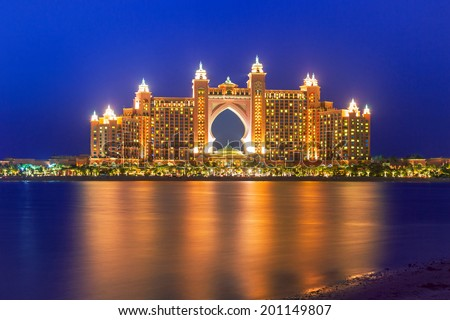DUBAI, UAE - 31 MARCH 2014: Atlantis hotel iluminated at night in Dubai, UAE. Atlantis the Palm is a luxury 5 star hotel built on an artificial island with over 1,500 guestrooms. - stock photo