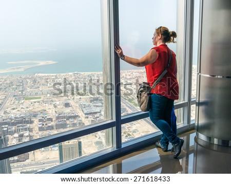 DUBAI, UAE - MARCH 16: Burj Khalifa on March 16, 2015 in Dubai, UAE. Burj khalifa is the highest building in the world. - stock photo