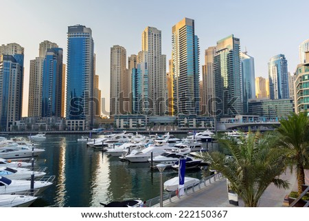 DUBAI, UAE - MARCH 30: City scenery of Dubai Marina on March 30, 2014, UAE. Dubai Marina is a district in Dubai with artificial canal skyscrapers who accommodates more than 120,000 people. - stock photo