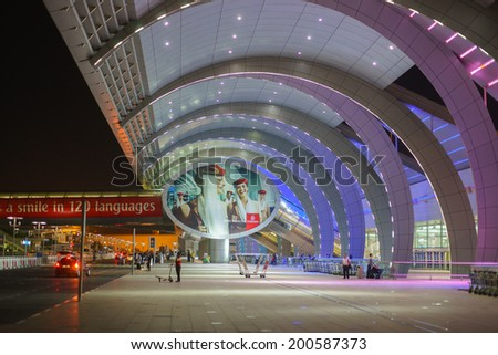 DUBAI, UAE - MARCH 26: Dubai Airport entrance on March 26, 2013. It is world largest building by floor space and world largest airport terminal. - stock photo