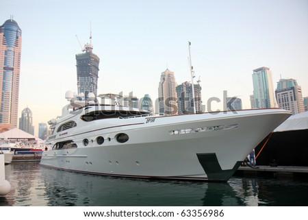 DUBAI, UAE - MARCH 13: Luxury Yachts on display during Dubai Boat Show 2010 at Dubai Marina Yacht club March 13, 2010 in Dubai, United Arab Emirates. - stock photo
