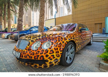 DUBAI, UAE - MARCH 30, 2014: Panther paint Bentley parked outside the Hilton Dubai Hotel on 30 March 2014, UAE. Dubai is one of the richest cities in the world with many luxury cars on streets. - stock photo