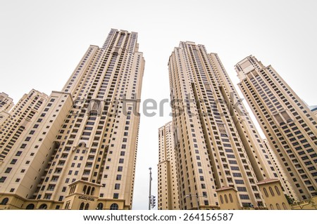 DUBAI, UAE - MARCH 16, 2015 : View of modern skyscrapers in Jumeirah beach residence on March 16, 2015 in Dubai, JBR - artificial canal city, carved along a 3 km stretch of Persian Gulf shoreline. - stock photo