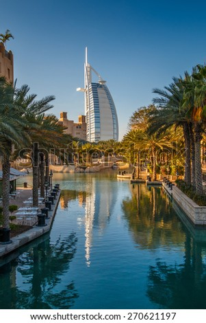 Dubai, UAE - March 29, 2015: View on Burj Al Arab from Madinat Jumeirah. Madinat is a luxury resort which include hotels and souk spreding across over 40 hectars. - stock photo