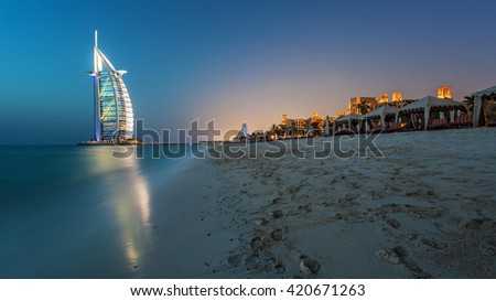 Dubai, UAE - MAY 28: Burj Al Arab Hotel on May 28 , 2011 in Dubai with Blue Hour Sunset with Luxury Beach View. Burj Al Arab is 7 Stars Hotel built on an artificial island in front of Jumeirah beach. - stock photo