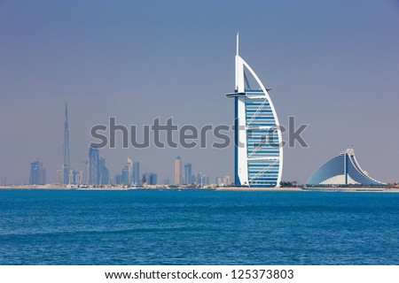 DUBAI, UAE - MAY 7 - Dubai has become known as the playground for architects and any skyline view will testify to that. This rare panorama showing Burj Khalifa and Burj Al Arab was taken in 2010. - stock photo