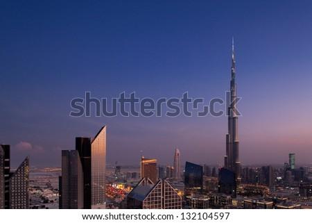 DUBAI, UAE - NOV 2: A skyline view of Downtown Dubai, showing the Burj Khalifa on Nov 2, 2011 in Dubai, UAE. Burj Khalifa, the tallest skyscraper in the world, 829.8 m, construction began in 2004 - stock photo