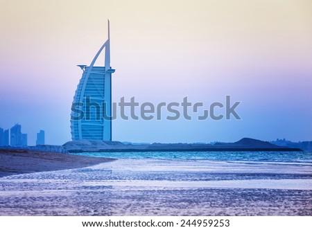 DUBAI, UAE - NOV 24: Burj Al Arab is 321m, second tallest hotel in the world, luxury hotel stands on an artificial island,November 24, 2014 Jumeirah beach, Dubai, United Arab Emirates - stock photo