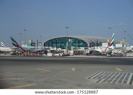 DUBAI, UAE - NOV 28: Emirates flights at Dubai Airport on November 28, 2012 in Dubai, UAE. Emirates handles major part of passenger traffic and aircraft movements at the airport. - stock photo