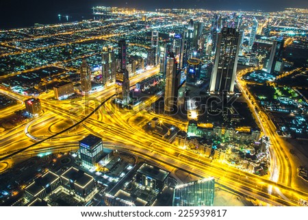 DUBAI, UAE - NOVEMBER 13: Aerial view of Downtown Dubai with man made lake and skyscrapers from the tallest building in the world, Burj Khalifa, at 828m, taken on 13 November 2013 in Dubai. - stock photo