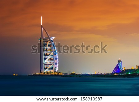 DUBAI, UAE - NOVEMBER 17: Burj Al Arab hotel on Nov 17, 2012 in Dubai. Burj Al Arab is a luxury 7 stars hotel built  in front of Jumeirah beach. - stock photo