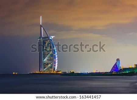 DUBAI, UAE - NOVEMBER 17: Burj Al Arab hotel on Nov 17, 2012 in Dubai. Burj Al Arab is a luxury 7 stars hotel built  in front of Jumeirah beach. - stock photo