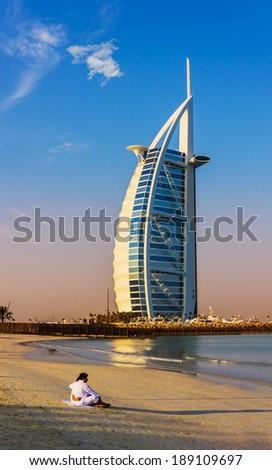 DUBAI, UAE - NOVEMBER 15: Burj Al Arab hotel on Nov 15, 2012 in Dubai. Burj Al Arab is a luxury 7 stars hotel built  in front of Jumeirah beach. - stock photo