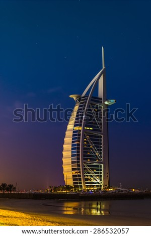 DUBAI, UAE - NOVEMBER 15: Burj Al Arab hotel on Nov 15, 2012 in Dubai. Burj Al Arab is a luxury 7 stars hotel built  in front of Jumeirah beach. - stock photo